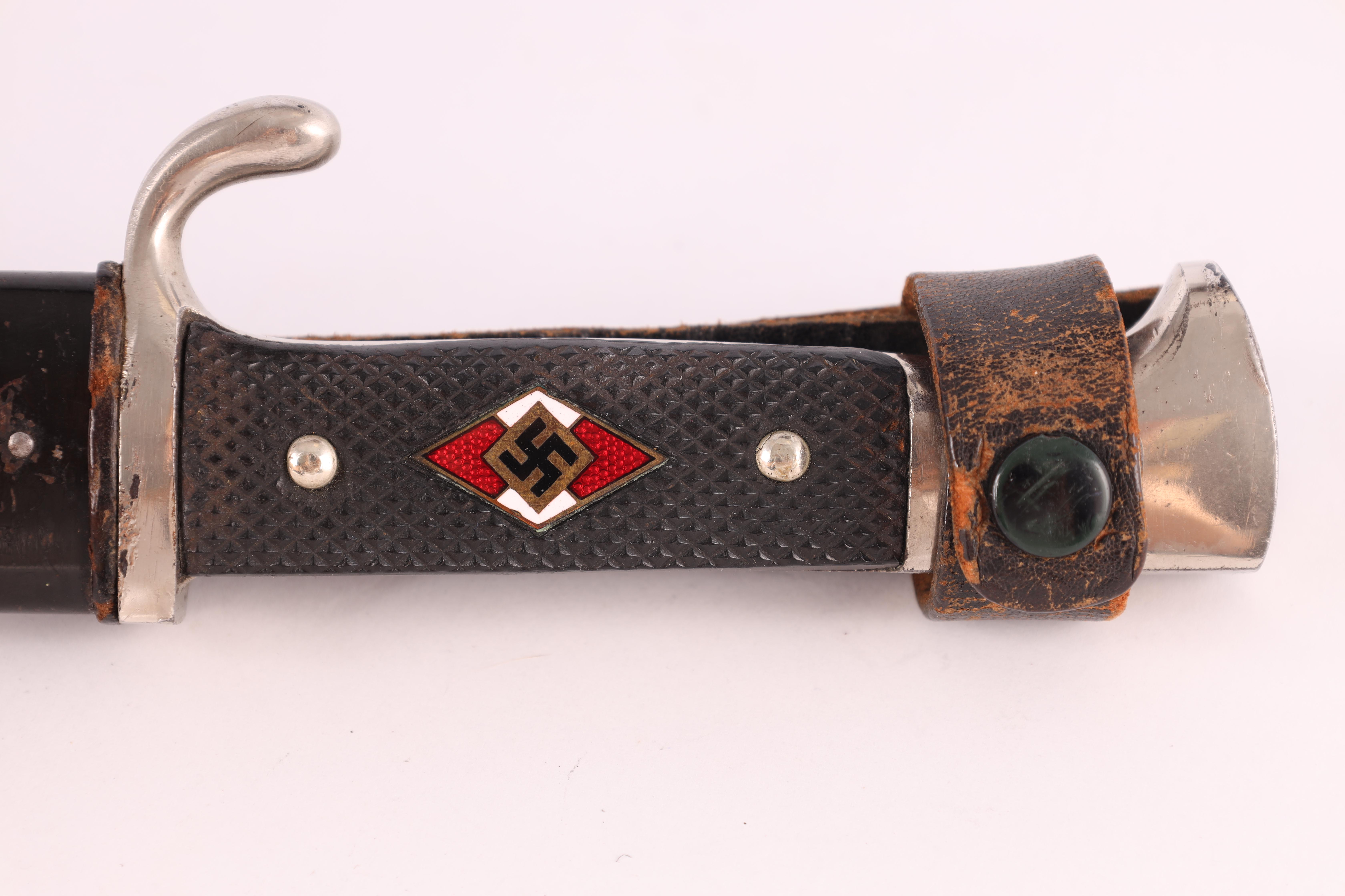 A WORLD WAR II GERMAN NAZI HITLER YOUTH DAGGER with checkered grip set with an enamel swastika badge - Image 3 of 9
