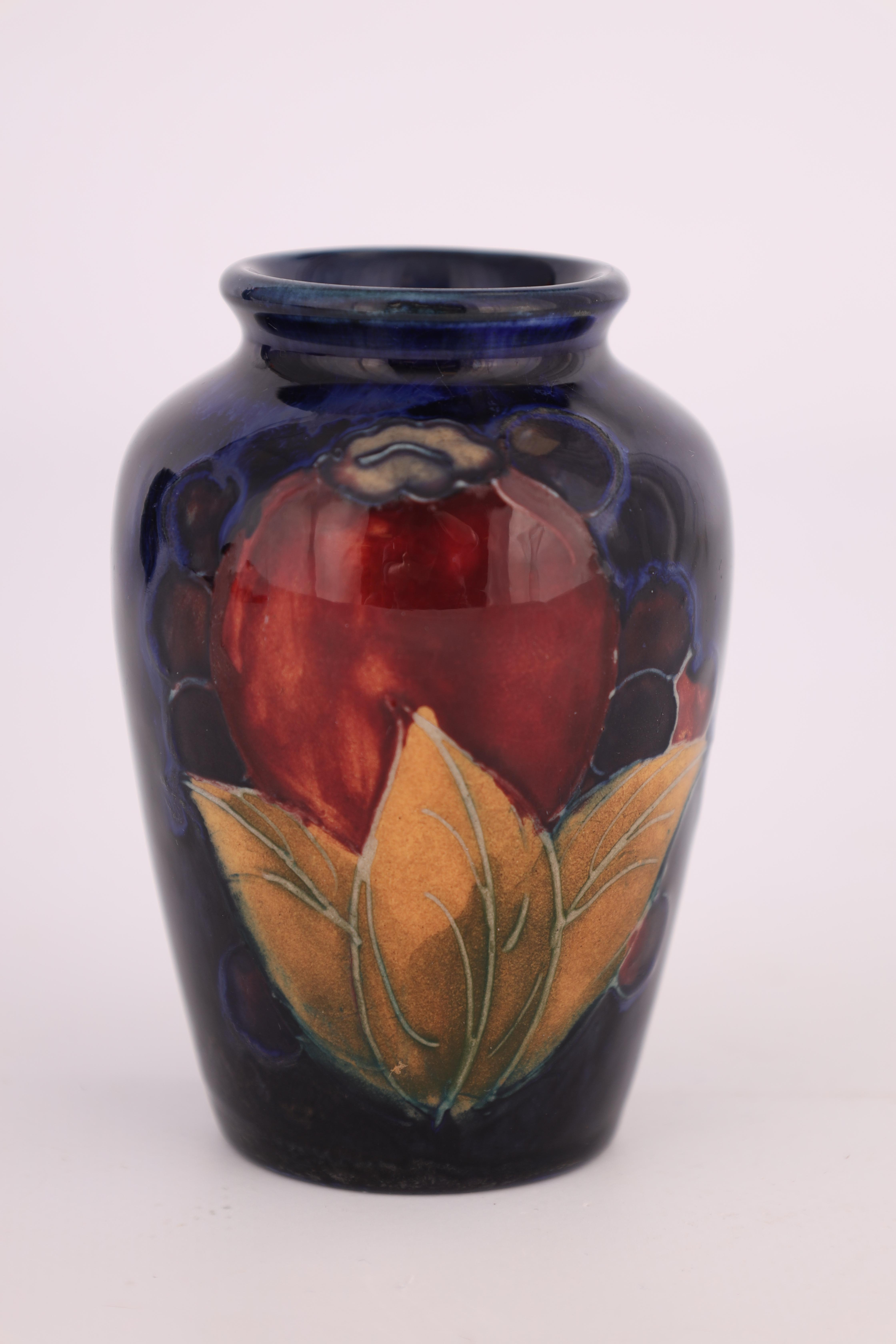A 1930S MOORCROFT SMALL SHOULDERED OVOID VASE decorated in the Pomegranate pattern on a dark mottled - Image 3 of 4