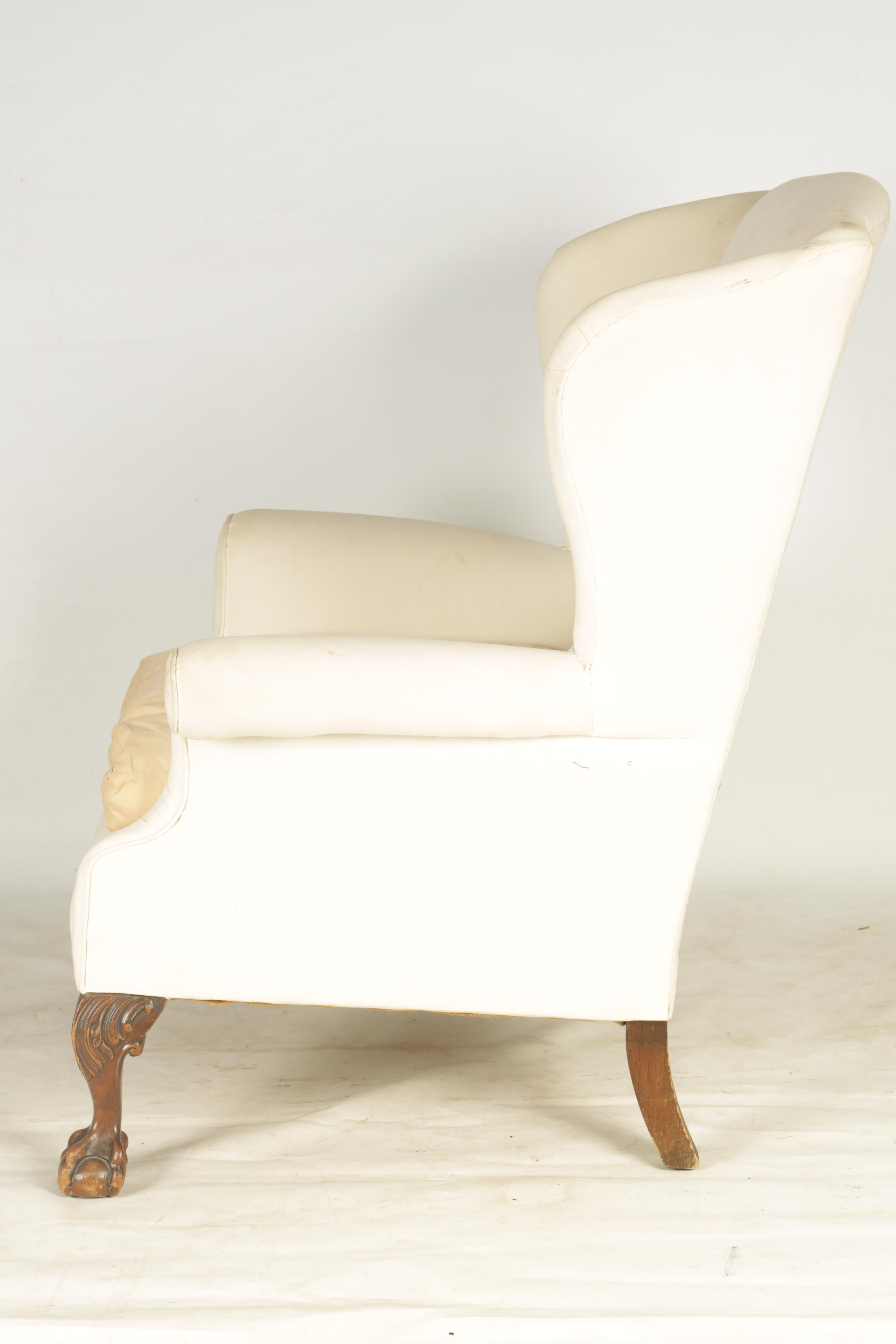 A LATE 19TH CENTURY GEORGE I STYLE WINGBACK UPHOLSTERED ARMCHAIR with mahogany leaf carved - Image 4 of 6
