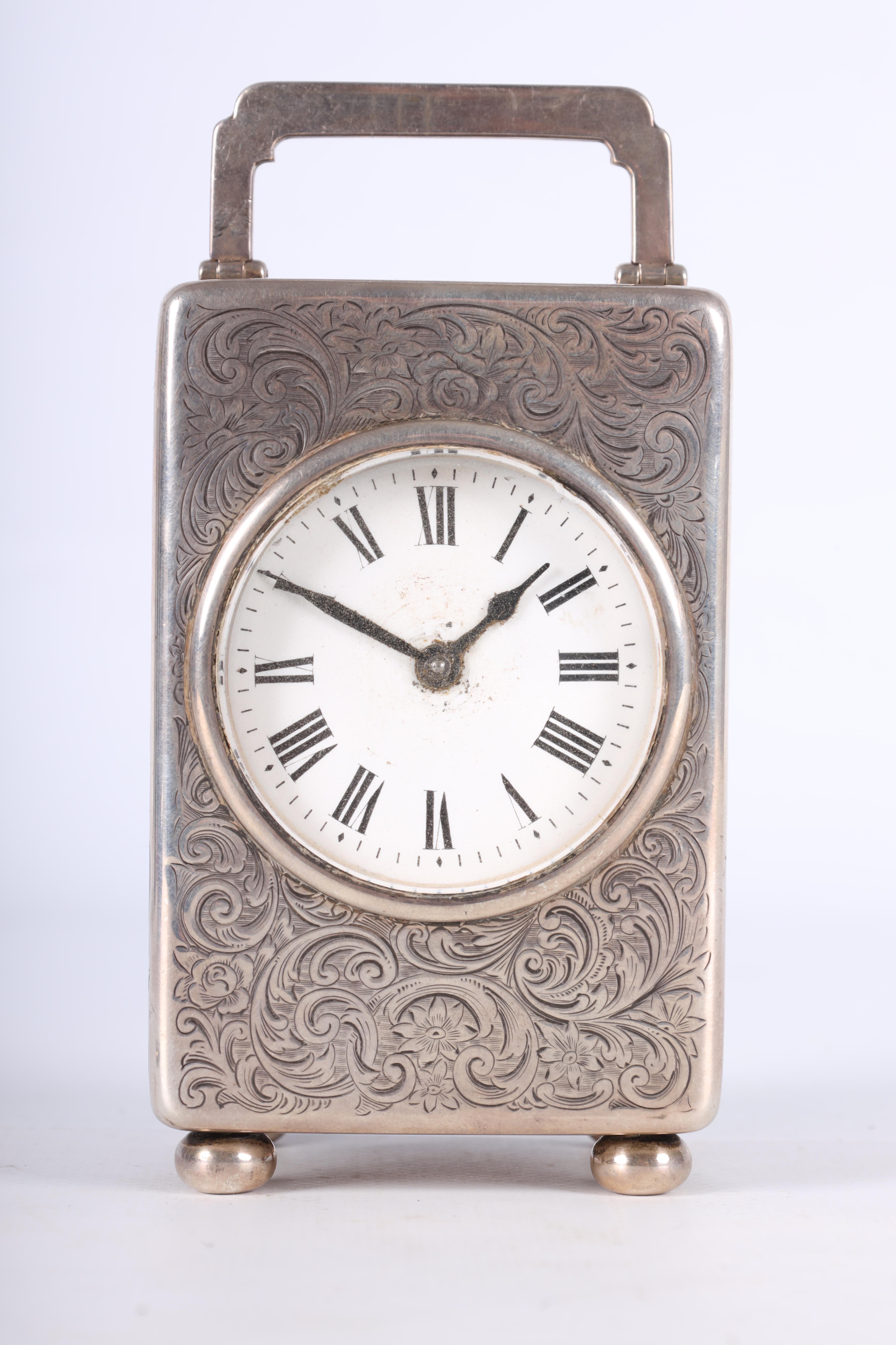 A LARGE EARLY 20TH CENTURY SILVER CASED CARRIAGE CLOCK the case covered with scrolling foliated - Image 3 of 10