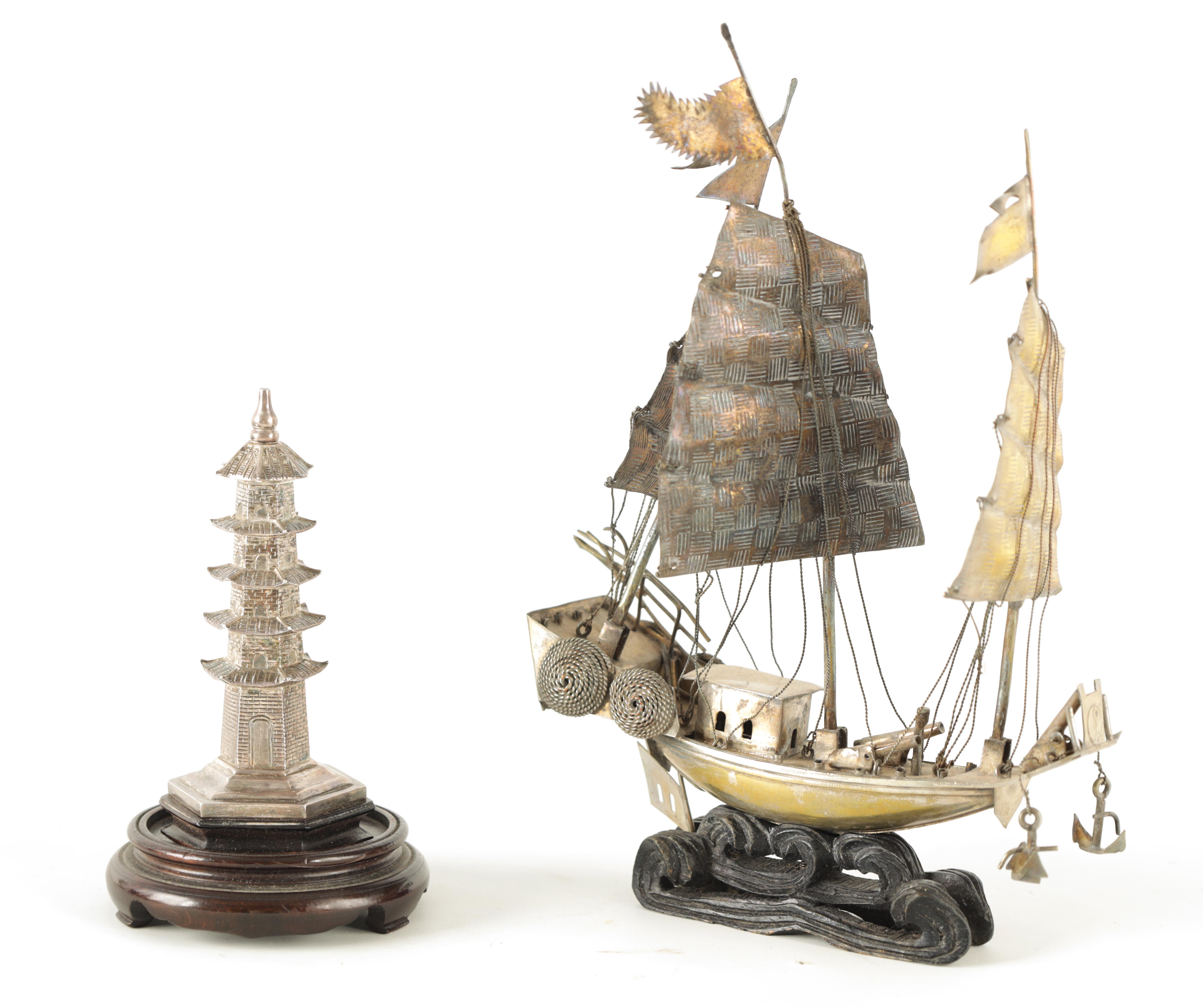 TWO 19TH CENTURY CHINESE SILVER MODELS comprising a pagoda-shaped tower on a hardwood base 13.5cm