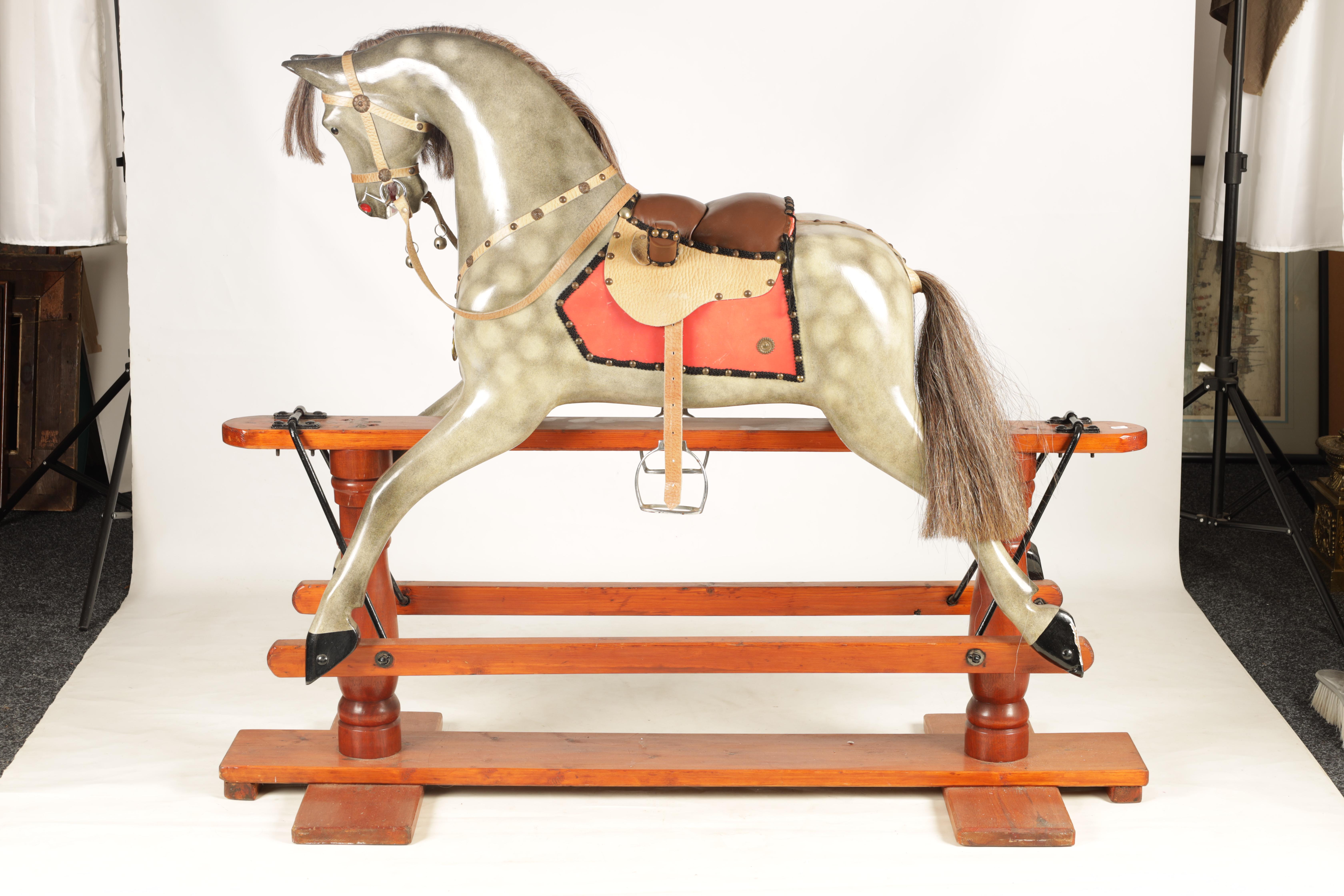 A 20TH CENTURY DAPPLE GREY PAINTED WOODEN ROCKING HORSE with leather seat and bridle 138cm wide - Image 7 of 8