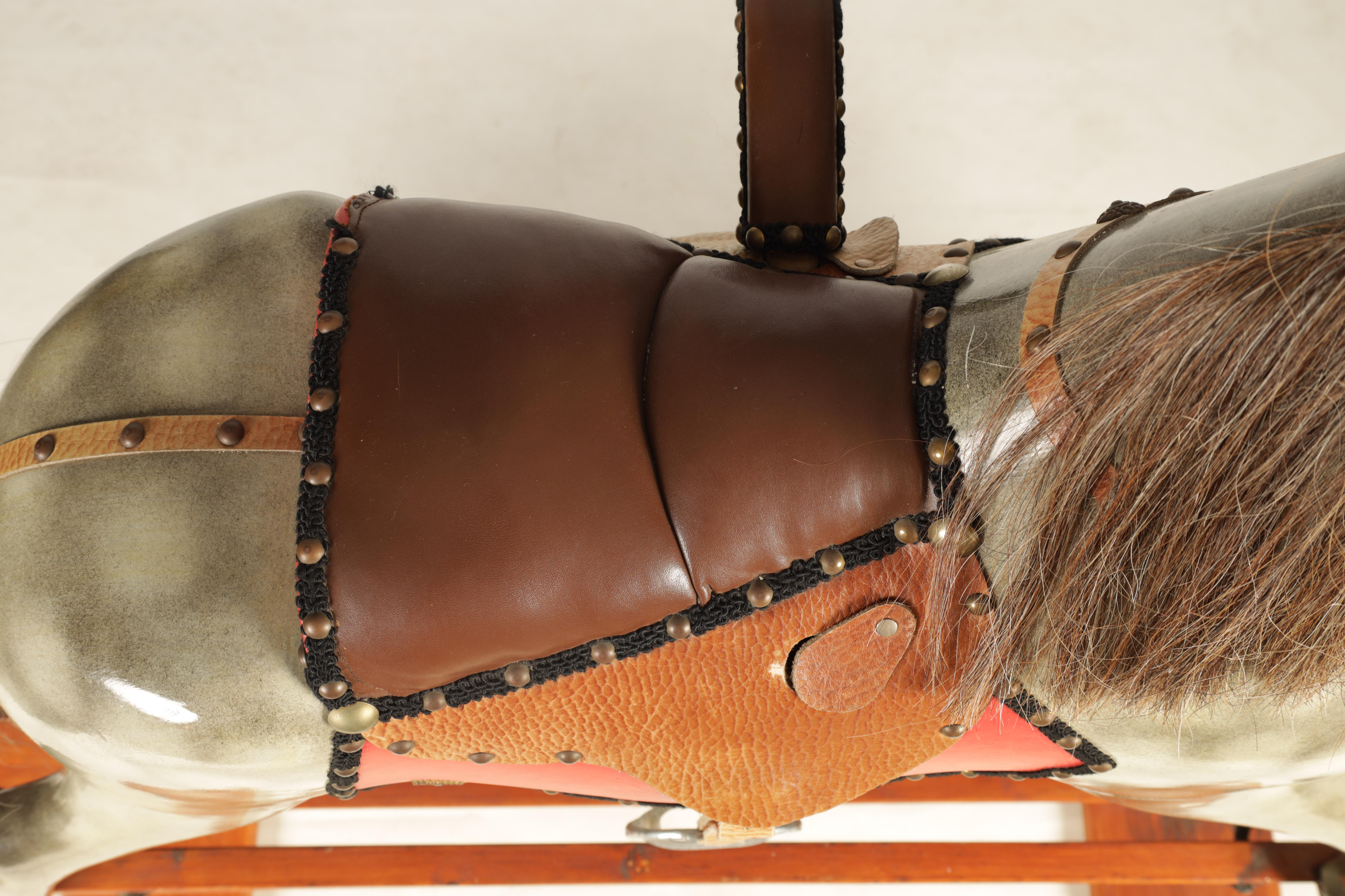 A 20TH CENTURY DAPPLE GREY PAINTED WOODEN ROCKING HORSE with leather seat and bridle 138cm wide - Image 3 of 8