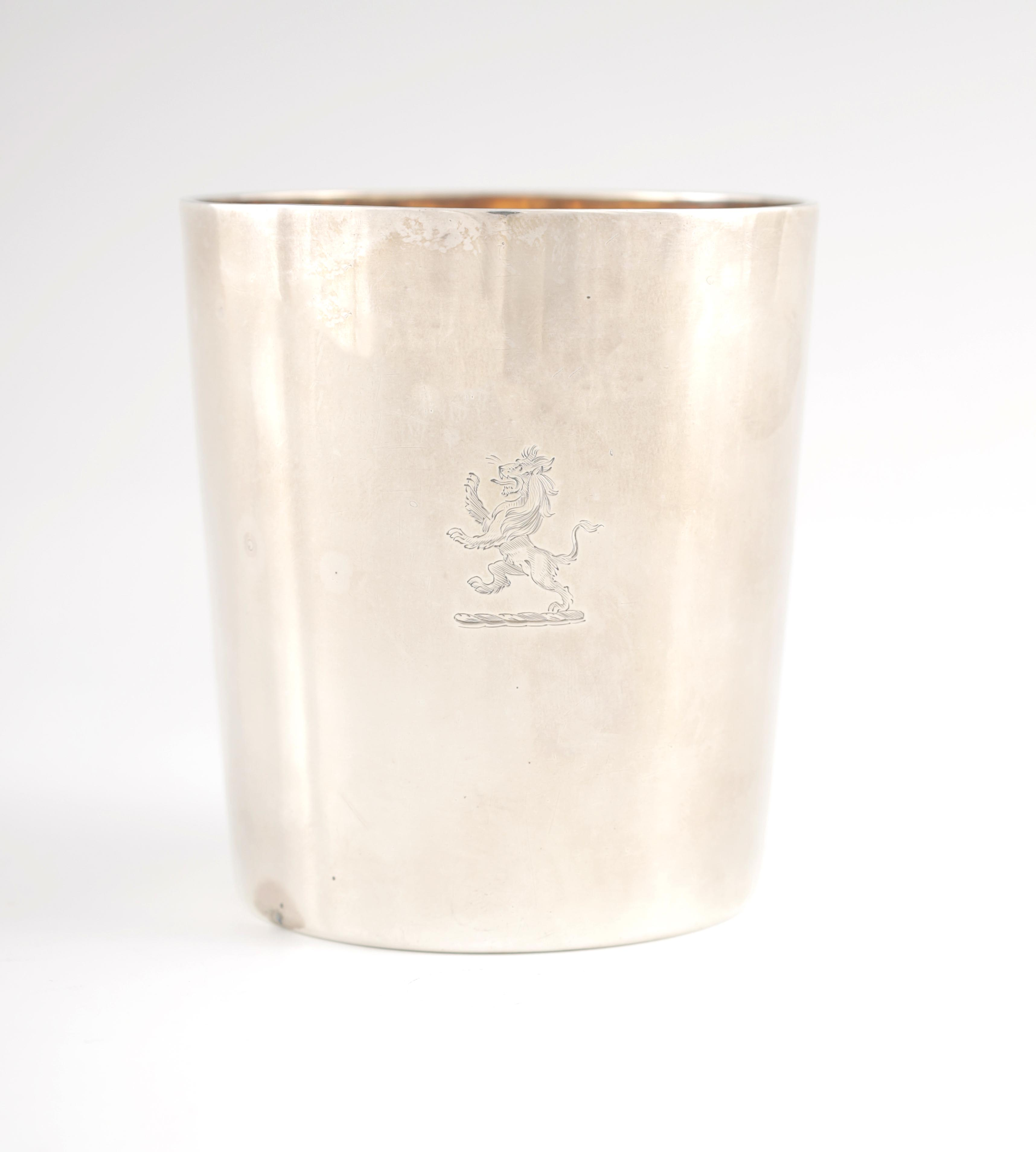 A GEORGE III SILVER BEAKER with gilt interior and coat of arms to the front, London 1802 9cm high