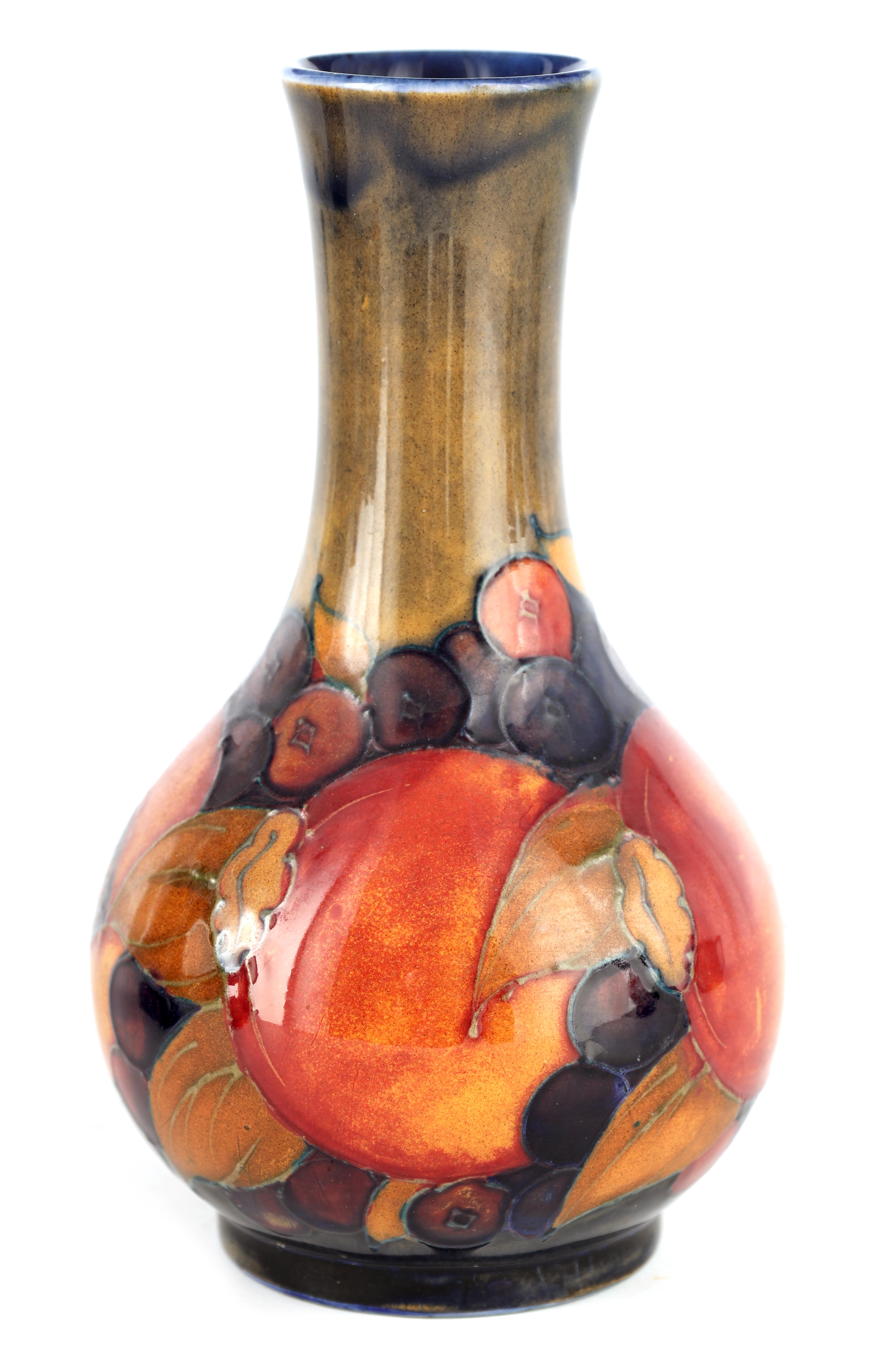 A 1930S/40S MOORCROFT BULBOUS VASE WITH SLENDER NECK tube lined and decorated in the Pomegranate
