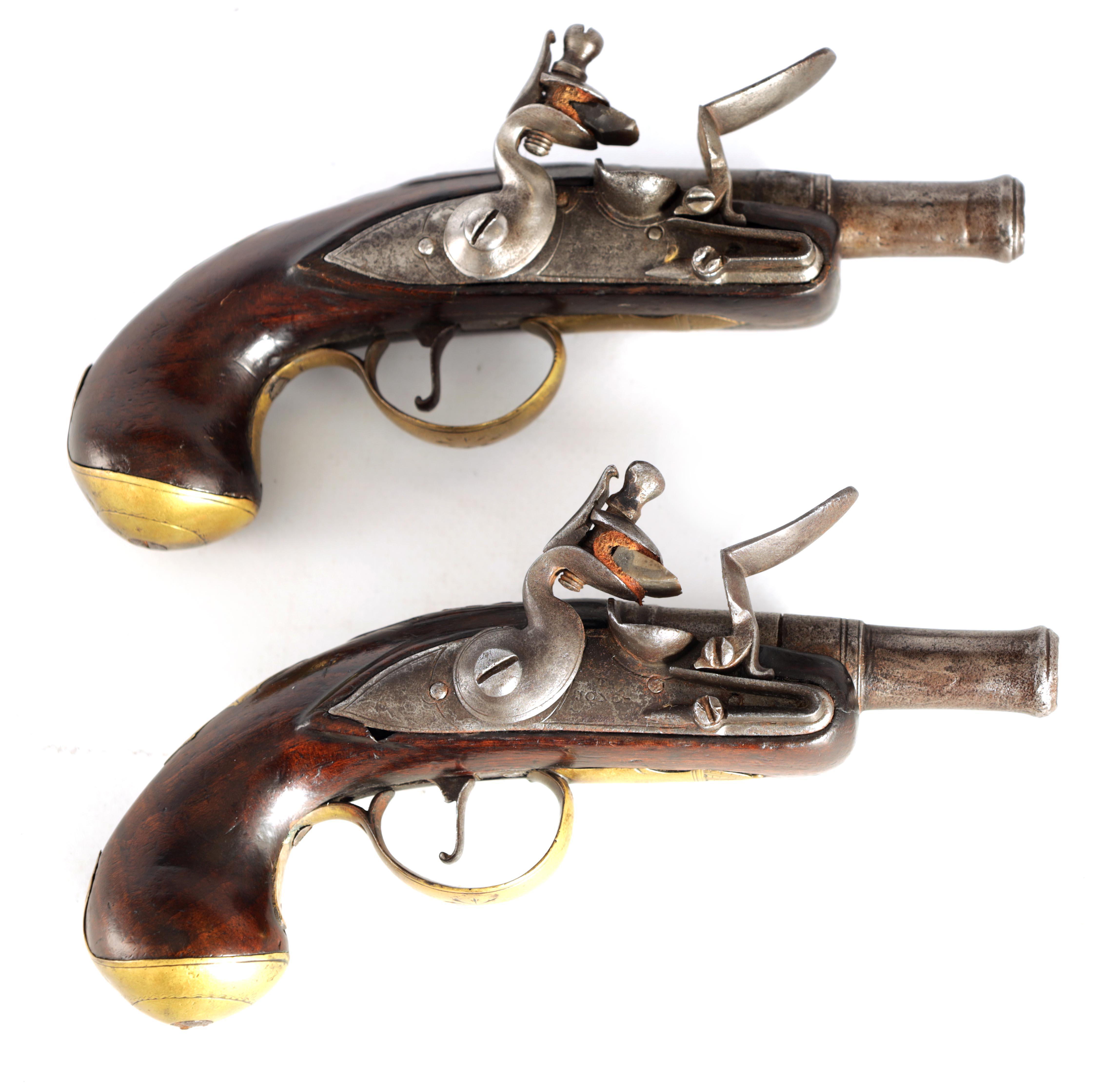 T. JONES. A PAIR OF EARLY 18TH CENTURY FLINTLOCK POCKET PISTOLS with turn-off cannon barrel,