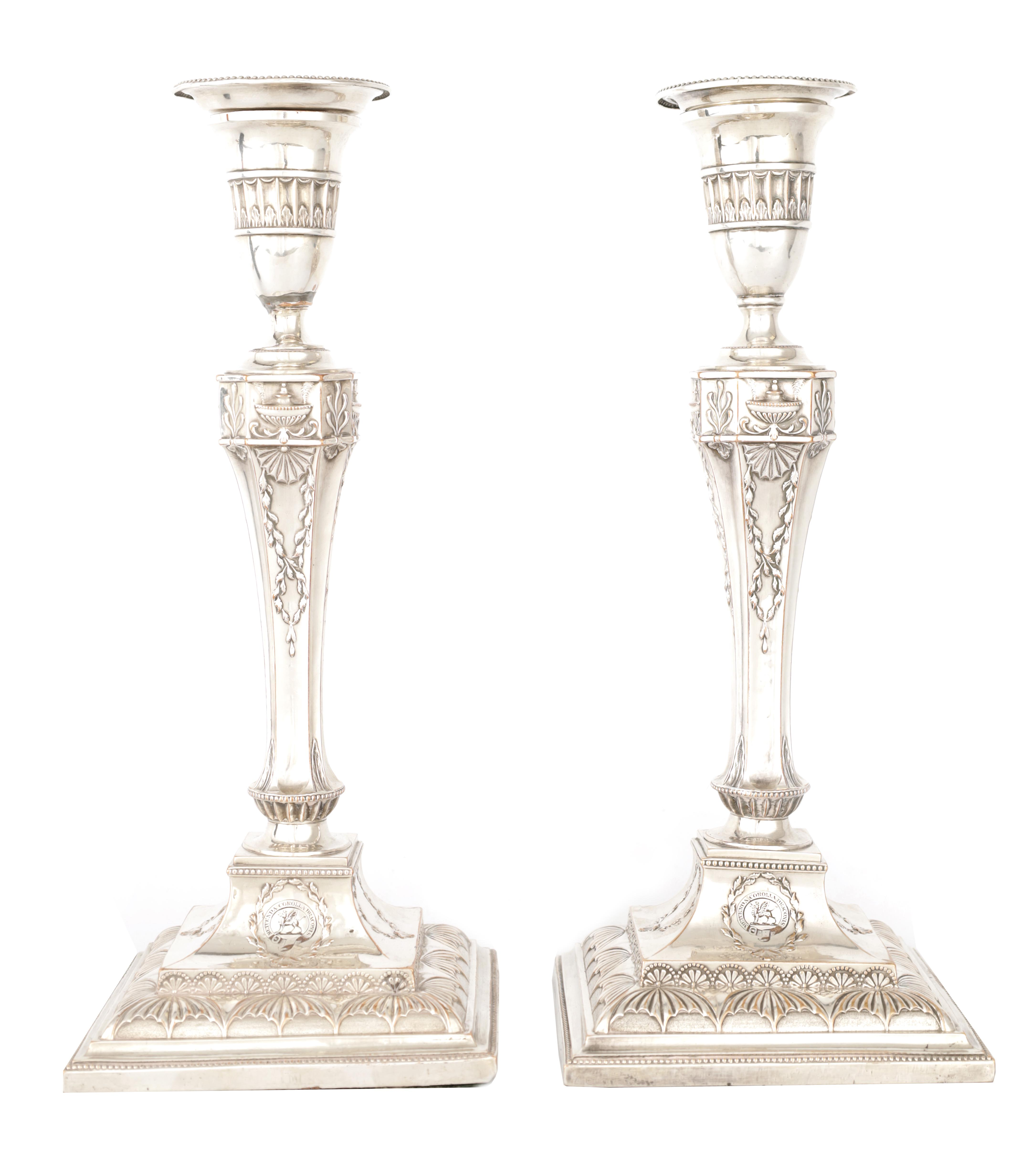 A PAIR OF 19TH CENTURY SHEFFIELD PLATE SILVER ON COPPER ADAM STYLE CANDLESTICKS bearing the crest
