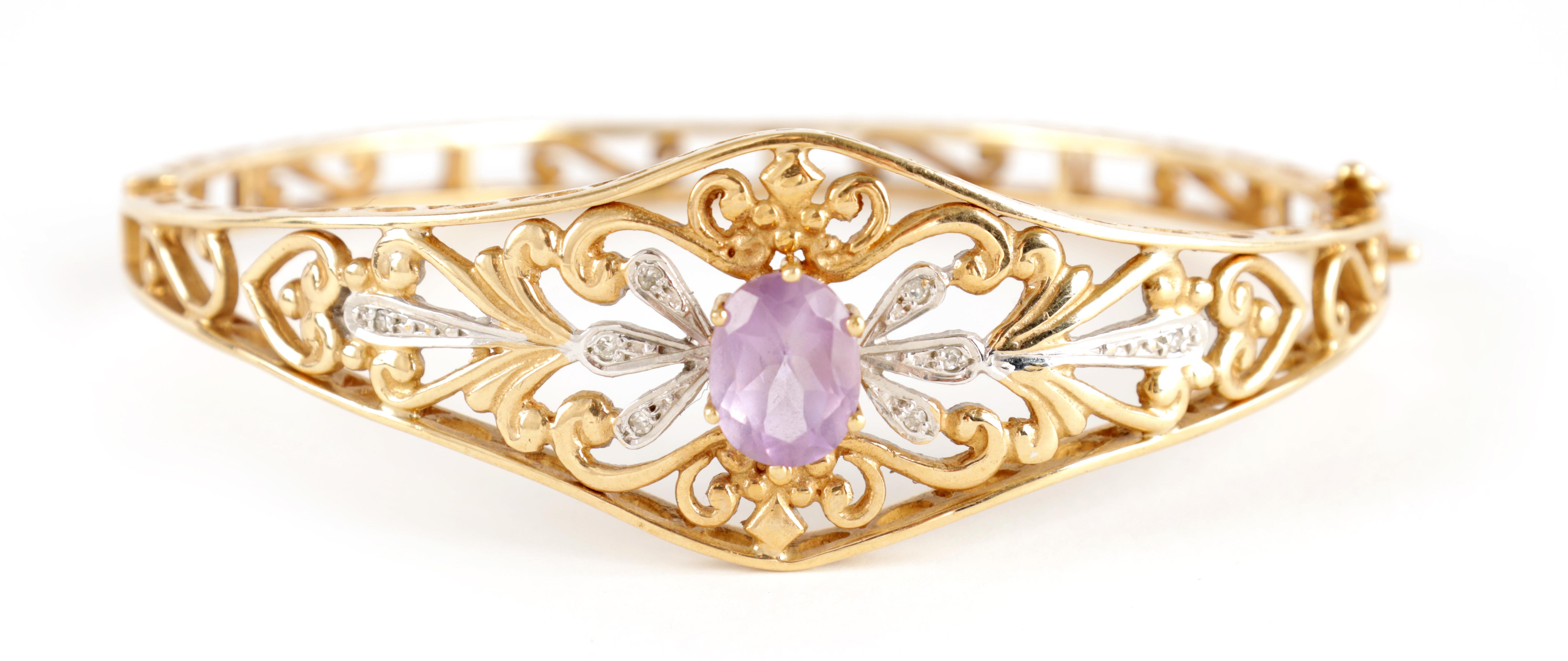 A LADIES 9CT GOLD DIAMOND AND AMETHYST BANGLE having filigree scrollwork decoration with diamonds