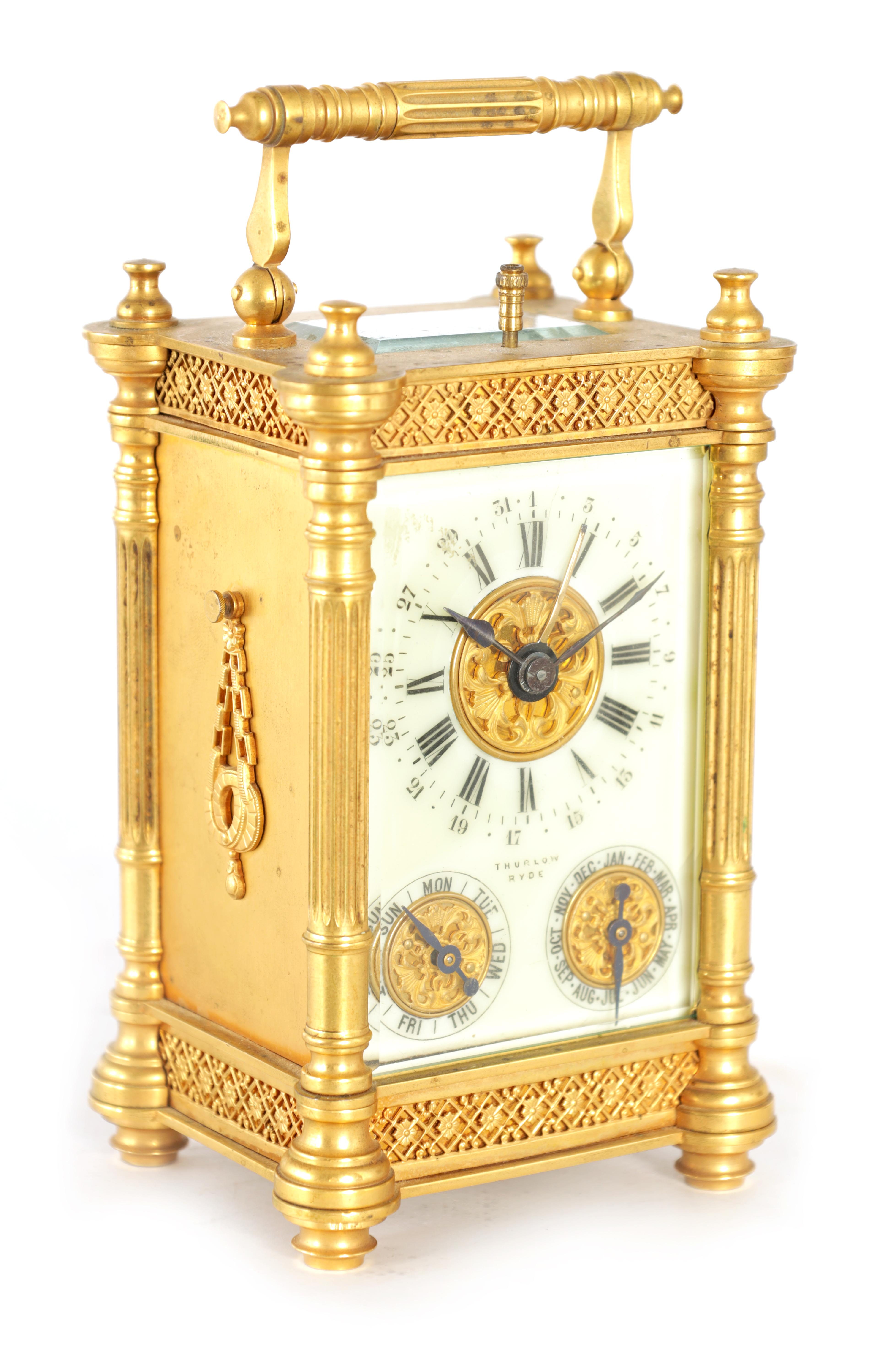 A LATE 19TH CENTURY FRENCH BRASS CARRIAGE CLOCK WITH CALENDAR the gilt case with pierced frieze