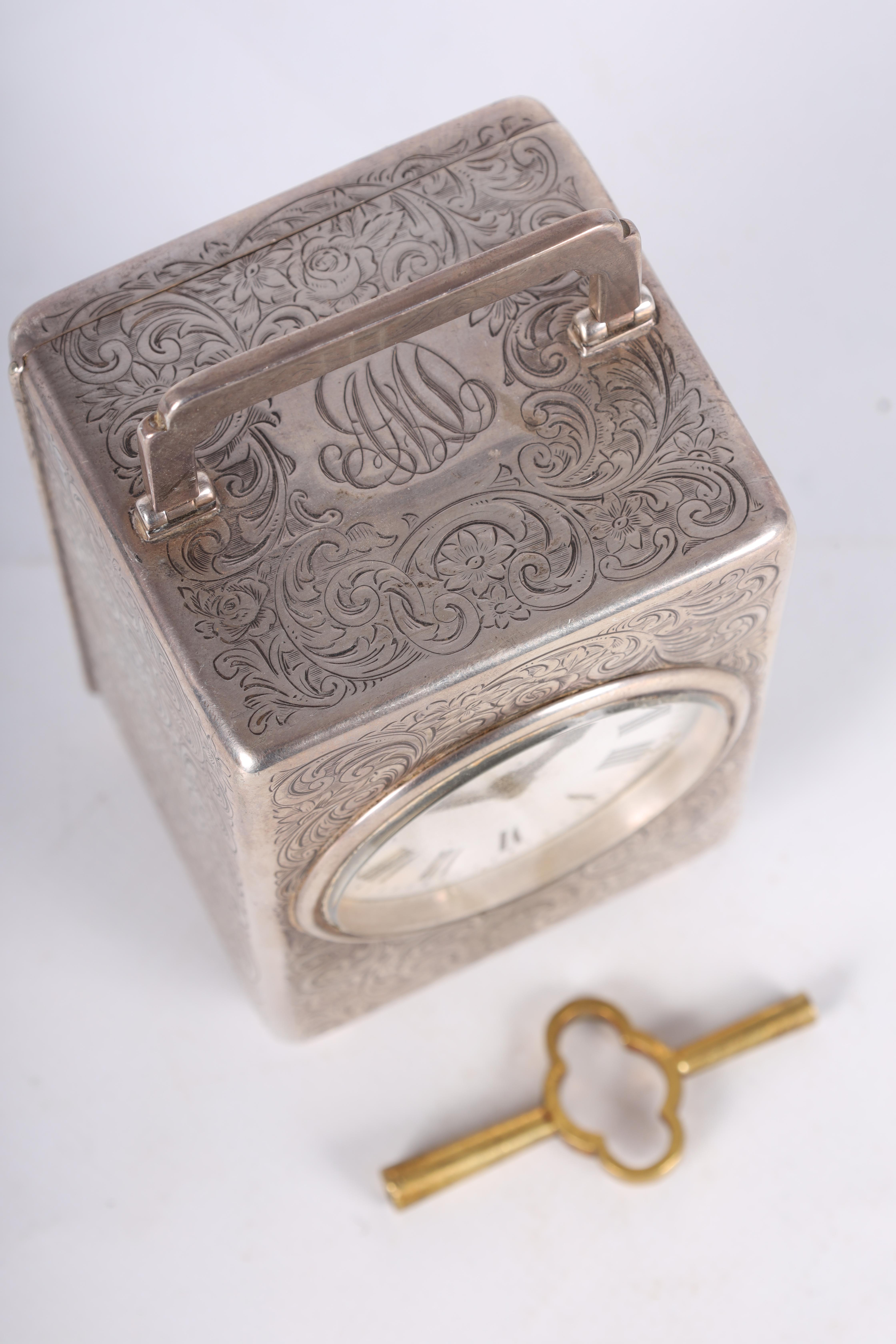 A LARGE EARLY 20TH CENTURY SILVER CASED CARRIAGE CLOCK the case covered with scrolling foliated - Image 4 of 10