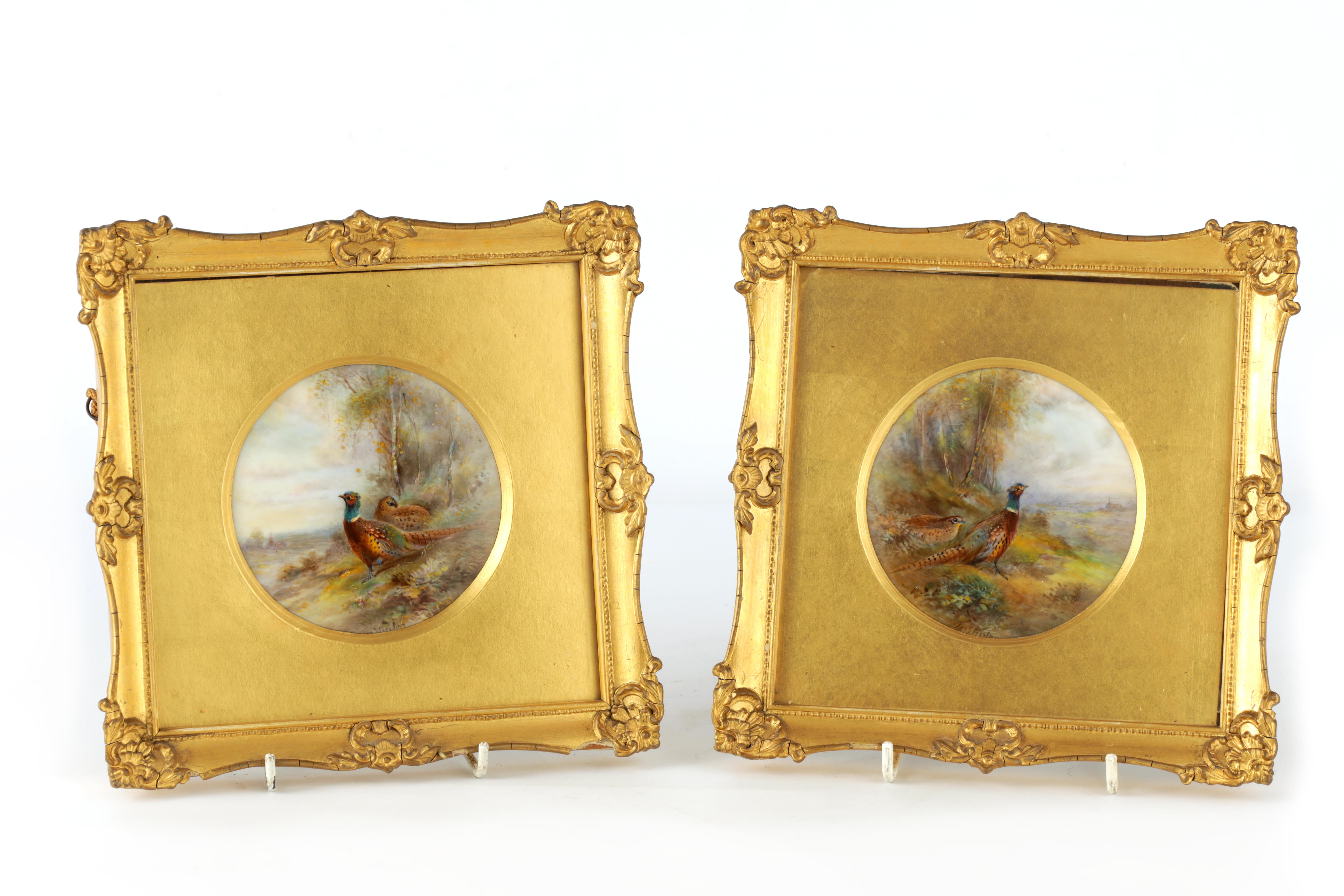 JAMES STINTON 1870-1961. A SIGNED PAIR OF ROYAL WORCESTER CIRCULAR PORCELAIN PLAQUES painted with