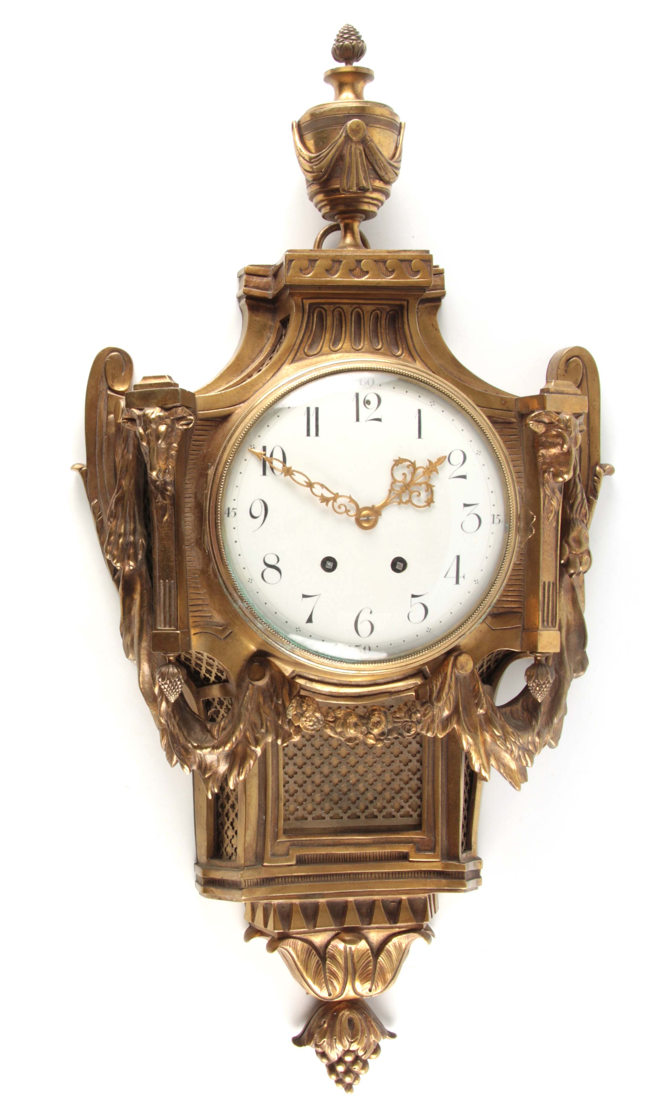 A LATE 19TH CENTURY FRENCH GILT BRASS CARTEL CLOCK with large urn finial and rams head decoration