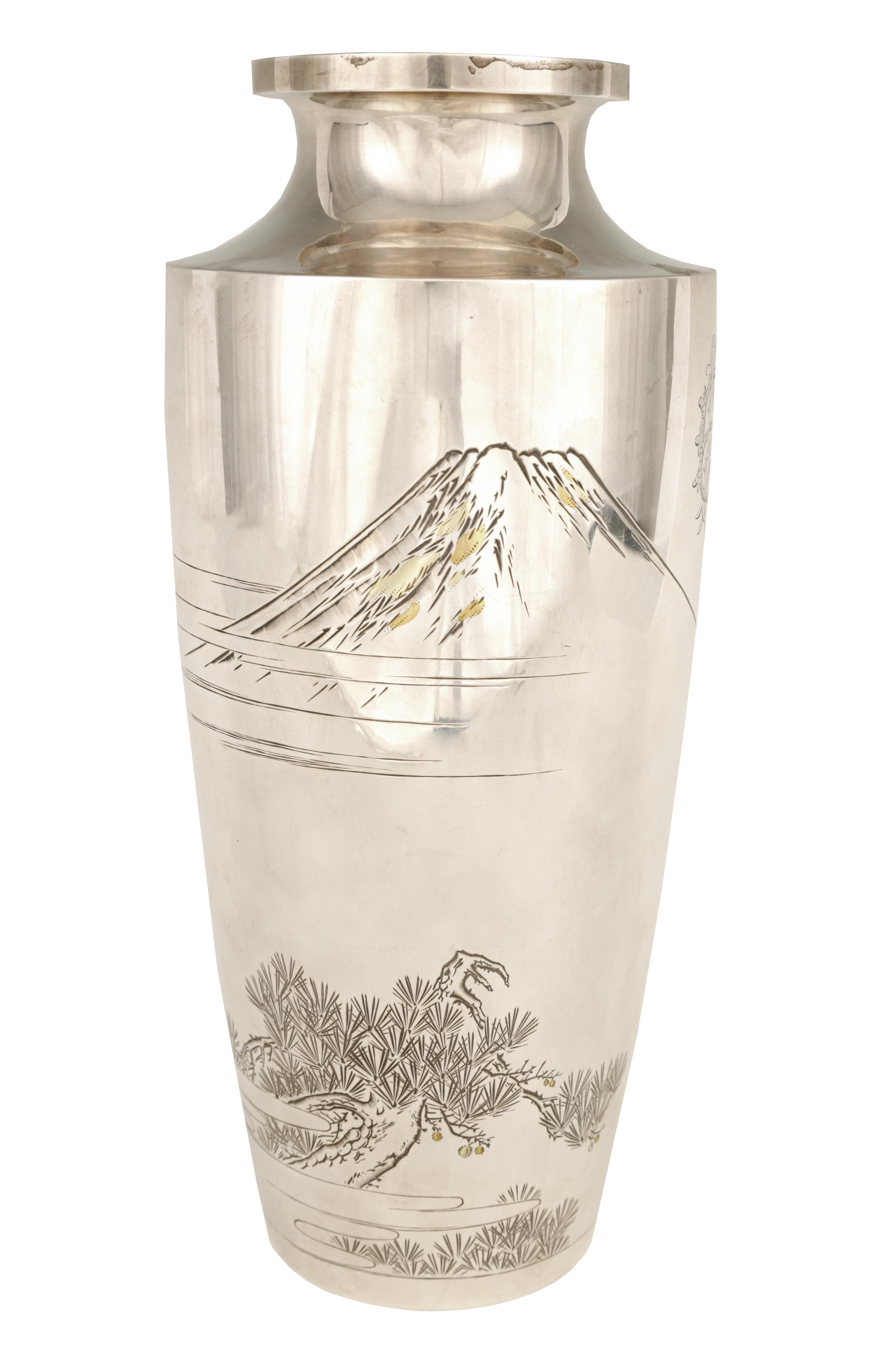 A LARGE JAPANESE MEIJI PERIOD SILVER VASE embellished with gilt highlights and engraved scene of