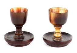 A PAIR OF LATE 19TH CENTURY MINIATURE RHINOCEROS HORN GERMAN CUPS