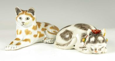 TWO CONTINENTAL PORCELAIN RECUMBENT CATS
