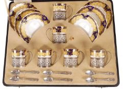 AN EARLY 20TH CENTURY AYNSLEY SILVER MOUNTED CASED COFFEE SET