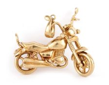 A VINTAGE 9CT GOLD MOTORCYCLE PENDANT
