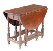AN 18TH CENTURY OAK GATE LEG TABLE OF SMALL SIZE