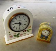 A Halcyon Days Buckingham Palace clock and a Wedgwood clock (both boxed)