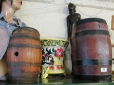 A majolica style jardinière, African model (a/f) and two oak barrels