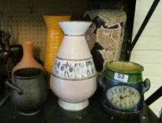 A tall Bretby oriental style vase and other vases