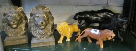 A pair of gilt lion bookends, three lion models and black panther (slightly a/f)