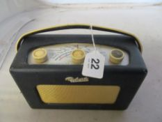 A vintage Roberts radio R200 in blue on swivel base