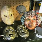 A pottery Bacchus face mask, pair of brass greek style masks and two others