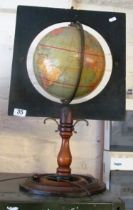 A Philips Terrestrial Globe on mahogany stand and square surround