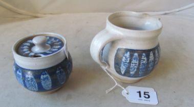 A Marianne de Trey pottery milk jug and matching marmalade pot