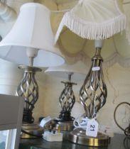 A set of three twist stem lamps