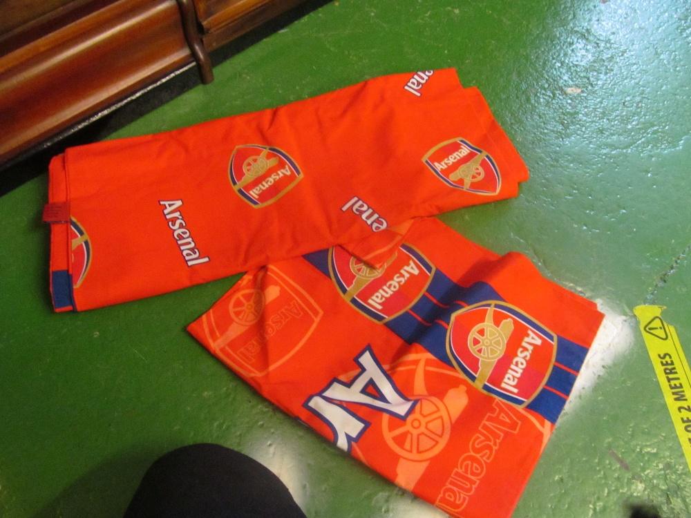 An Arsenal pillow case and sheet