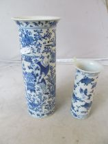 A modern Chinese bowl decorated butterflies and flowers (a/f) and two blue and white vases (a/f)