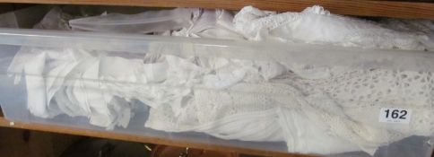 A linen cot sheet, lace edged linen and other linen