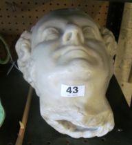 A plaster marble effect bust of a gentleman