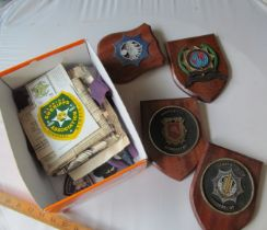 A box of Police plaques, photos, badges etc