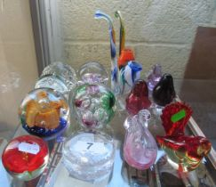 Seven glass paperweights, two glass pipes and various glass birds