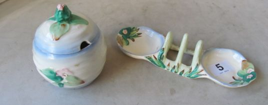 A Clarice Cliff lidded preserve jar floral design and similar breakfast piece with central toastrack