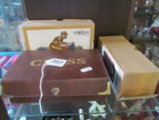 A modern tinplate motorcycle rider, a vintage bus (both boxed) and modern chess set