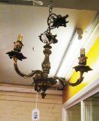An ormulu three branch chandelier