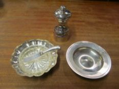 A silver pepper mill, dish, butter dish with glass liner and a knife