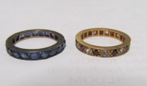 A gold eternity ring set red stones and diamond 2.2g and another eternity ring