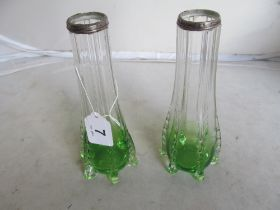 A pair of green and clear glass late Victorian vases with silver rims