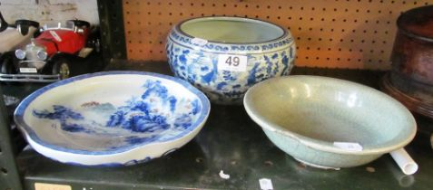 An Oriental blue and white bowl (a/f), celadon bowl (a/f) and a dish decorated landscape