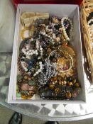 A box of gemstone and pearl bracelets