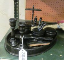 A group of ebony dressing table items