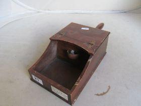 A mahogany ballot box with black and white pellets