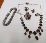 A set of Indian garnet jewellery:- bracelet, necklace, earrings, ring, necklace and flower brooch