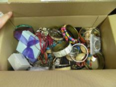 A box of costume bangles and earrings