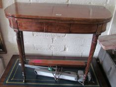 A 19th Century card table on reeded legs